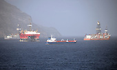 Mothballed oil rigs in the Santa Cruz port on Tenerife on Saturday, November 11, 2017. The Canary Islands ports are used by a number of oil companies for mothballing (preserving and storing production assets without using them to produce) rigs from the African and South American off shore oil fields for long periods of time due to the oversupply of product and the resulting fall in crude oil prices. <br /> Credit: Ron Sachs / CNP