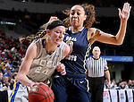 SIOUX FALLS, SD - MARCH 9: Megan Waytashek #24 drives against defender Atoe' Jackson #0 of Oral Roberts in the first half of their semi-final round Summit League Championship Tournament game Monday afternoon at the Denny Sanford Premier Center in Sioux Falls, SD. (Photo by Dick Carlson/Inertia)