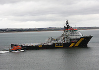 Oil Supply ship Caledonian Vision leaving Aberdeen harbour and being overtaken by the Royal National Lifeboat Bon Accord.