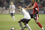 10 September 2008: Steve Cherundolo (USA)(6) tries to shield the ball from Densill Theobald (TRI)(right).  The United States Men's National Team defeated the Trinidad and Tobago Men's National Team 3-0 at Toyota Park in Bridgeview, Illinois in a CONCACAF semifinal round FIFA 2010 South Africa World Cup Qualifier.