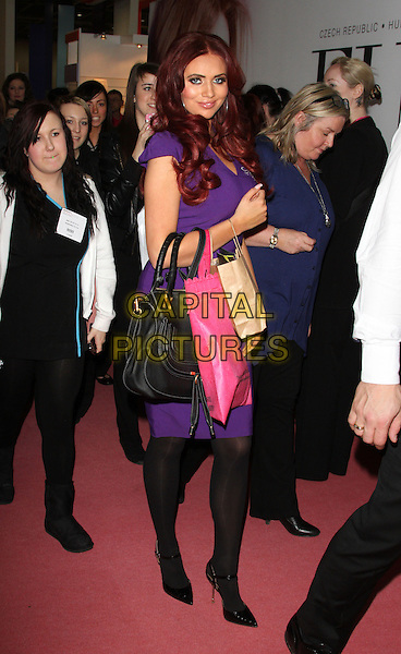 Amy Childs .appears at the Professional Beauty Show at Excel Centre, London, England..February 25th 2013.full length dress black tights purple bags purple shopping .CAP/ROS.©Steve Ross/Capital Pictures..