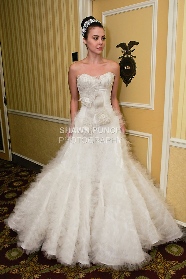 Model poses in a wedding dress from Karen Sabag Spring 2012 Bridal collection, during  Couture: New York Bridal Fashion Week 2012