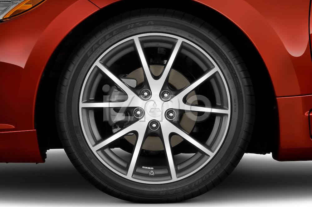 Tire and wheel close up detail view of a 2009 Mitsubishi Eclipse GT Spyder Convertible