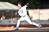 Asheville Tourists starting pitcher Dylan Craig (18) delivers a pitch during a game against the Hagerstown Suns  at McCormick Field on June 7, 2016 in Asheville, North Carolina. The Tourists defeated the Suns 6-5. (Tony Farlow/Four Seam Images)
