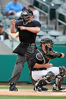 Home plate umpire Garrett Patterson makes a call behind Jupiter Hammerheads catcher J.T. Realmuto during a game against the Bradenton Marauders at Roger Dean Stadium on April 30, 2012 in Jupiter, Florida.  Bradenton defeated Jupiter 8-0.  (Mike Janes/Four Seam Images)