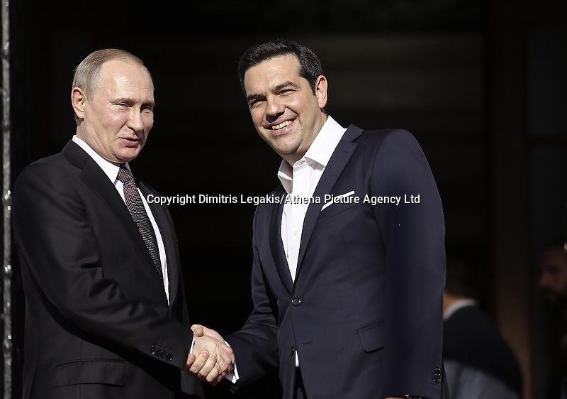 Pictured L-R: Vladimir Putin and Alexis Tsipras greet each other on the steps of Maximos Mansion Friday 27 May 2016<br /> Re: Russian President Vladimir Putin meets with Greek Prime Minister Alexis Tsipras at Maximou Mansion, Athens, Greece