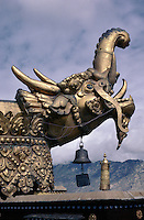 "A gold ""elephant"" gable end, and the bell which hangs from it, on the roof of the Jokhang Temple in Tibet's capital, Lhasa."