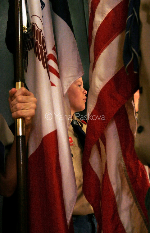 A boy scout and his scout friends prepare to introduce Republican Presidential hopeful Rudy Giuliani (R-NY) during his campaign at the Woodrow Wilson Junior High School gymnasium in Council Bluffs, IA, on July 18, 2007. .