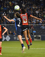 Kansas City, Kansas - Saturday April 16, 2016: FC Kansas City midfielder Mandy Laddish (7) goes for a header against Western New York Flash defender Jessica McDonald (14) in the first half at Children's Mercy Park.
