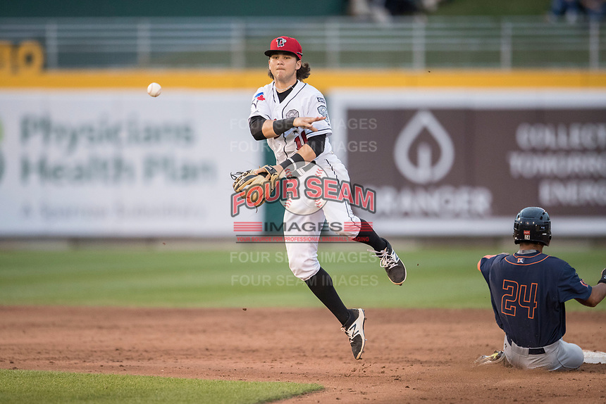 Lansing Lugnuts shortstop Bo Bichette (10) turns a double play as Bowling Green Hot Rods baserunner Garrett Whitley (24) slides into the base during the Midwest League baseball game on June 29, 2017 at Cooley Law School Stadium in Lansing, Michigan. Bowling Green defeated Lansing 11-9 in 10 innings. (Andrew Woolley/Four Seam Images)