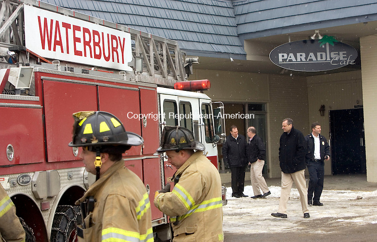 WATERBURY, CT. 28 January 2011-012811SV09--Firefighters investigate a roof collapse at the Paradise Pub on Store Avenue in Waterbury Friday. Steven Valenti Republican-American