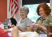 NWA Democrat-Gazette/BEN GOFF &bull; @NWABENGOFF<br /> Joan Abrams (left) works on a knitted piece as Lois Allen, both of Bella Vista, works on a cross stitch design on Monday Aug. 3, 2015 during the weekly meeting of the B&rsquo;Creative Stitchers at the Bella Vista Public Library.