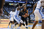 CHAPEL HILL, NC - DECEMBER 03: Tulane's Cam Reynolds (5) and North Carolina's Kenny Williams (left). The University of North Carolina Tar Heels hosted the Tulane University Green Wave on December 3, 2017 at Dean E. Smith Center in Chapel Hill, NC in a Division I men's college basketball game. UNC won the game 97-73.