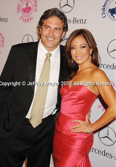 BEVERLY HILLS, CA - OCTOBER 20: Carrie Ann Inaba and Jesse Sloan arrive at the 26th Anniversary Carousel Of Hope Ball presented by Mercedes-Benz at The Beverly Hilton Hotel on October 20, 2012 in Beverly Hills, California.