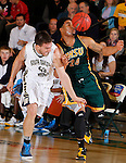 NOVEMBER 17, 2014 -- Andrew Rebol #55 of South Dakota Mines chases a loose ball with Yoshio Allen #24 of Black Hills State during their college men's basketball game Monday evening at the Donald E. Young Center in Spearfish, S.D.  (Photo by Dick Carlson/Inertia)