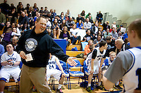 Grandview High School unified basketball head coach Cory Chandler (cq) supports his team during a game against Overland High School at Grandview High School in Aurora, Colorado, Wednesday, February 1, 2012. Unified sports teams, an outgrowth of the Special Olympics, are teams with both special needs and traditional high school students as players. The idea is that special needs kids shouldn't be separated and be allowed to participate in a competitive games as well at their schools...Photo by Matt Nager
