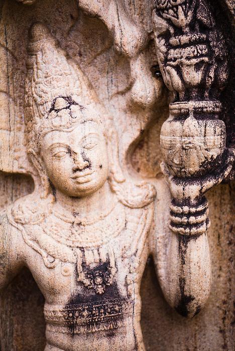 Polonnaruwa Ancient City, stone guardian figure at the Vatadage (Circular Relic House) in Polonnaruwa Quadrangle, UNESCO World Heritage Site, Sri Lanka, Asia. This is a photo of a stone guardian figure at the Vatadage (Circular Relic House) in Polonnaruwa Quadrangle at Polonnaruwa Ancient City, a UNESCO World Heritage Site in Sri Lanka, Asia.