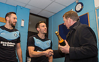 Paul Hayes of Wycombe Wanderers & Matt Bloomfield of Wycombe Wanderers with BBC Presenter Bill Turnbull during the Sky Bet League 2 match between Wycombe Wanderers and Exeter City at Adams Park, High Wycombe, England on 13 February 2016. Photo by Andy Rowland.