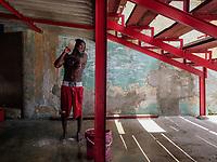 HAVANA, CUBA - JUNE 15: Cuban boxer, Maikel L. Masso, washes himself after training, at a boxing gymnasium in Old Havana, Habana Vieja on June 15, 2015 in Havana, Cuba. <br /> Daniel Berehulak for Panasonic/Lumix