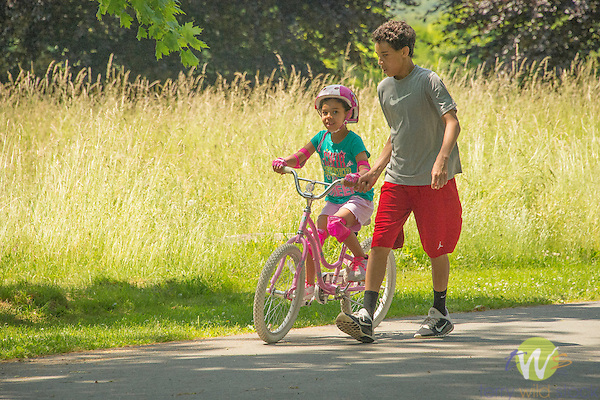 Harkness Memorial State Park. Boy teaching sister how to ride bike.