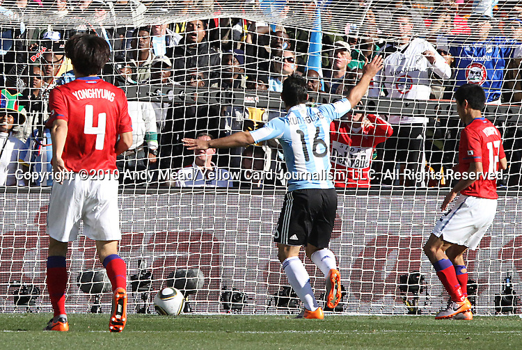 17 JUN 2010:  Sergio Aguero (ARG)(16) begins to celebrate the third goal scored by Gonzalo Higuain (ARG)(not pictured) as Cho Yong Hyung (KOR)(4) and Lee Young Pyo (KOR)(12) watch the ball enter the goal.  The Argentina National Team defeated the South Korea National Team 4-1 at Soccer City Stadium in Johannesburg, South Africa in a 2010 FIFA World Cup Group E match.