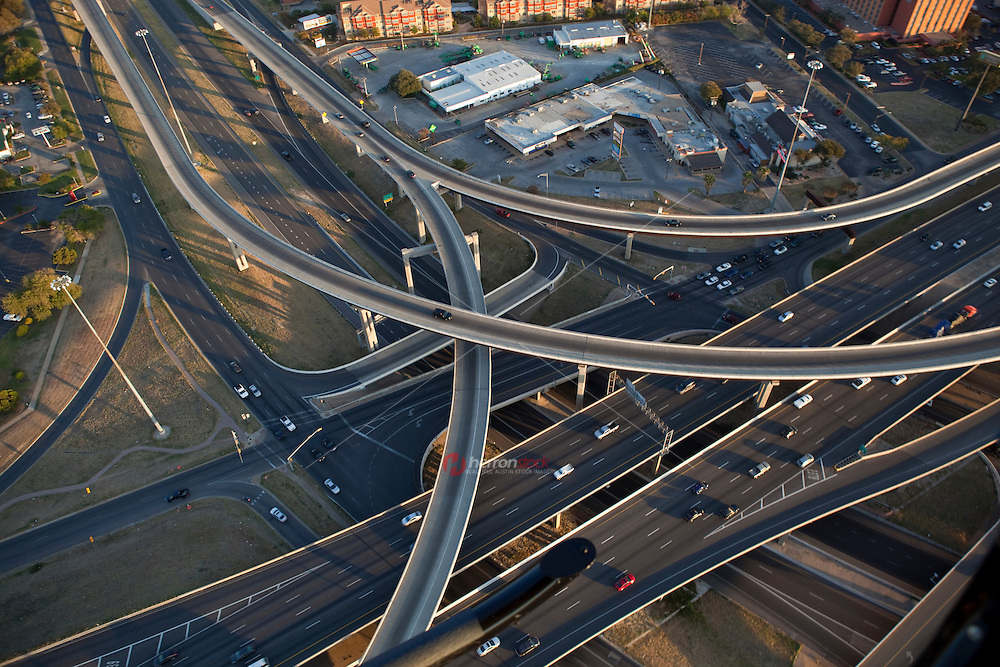 """Aerial view from a helicopter of I-35 and 290 Highway Interchanges """"Spagetti Highway"""" in Austin, Texas."""