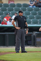 Umpire Thomas O'Neil works the plate during the South Atlantic League game between the Hagerstown Suns and the Kannapolis Intimidators at Kannapolis Intimidators Stadium on August 27, 2019 in Kannapolis, North Carolina. The Intimidators defeated the Suns 5-4. (Brian Westerholt/Four Seam Images)