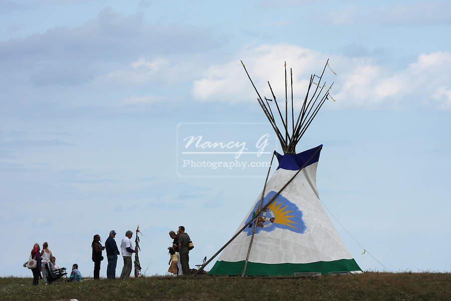Tourists surrounding a tipi on the shoreline of Lake Michigan at the Milwaukee Lakefront Indian Summer Festival, Wisconsin