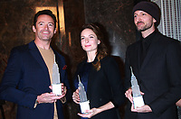 NEW YORK, NY - DECEMBER 9: Hugh Jackman, Rebecca Ferguson, Michael Gracey pictured as the cast of The Greatest Showman attend the Empire State Building in New York City on December 9, 2017. Credit: RW/MediaPunch /nortephoto.com NORTEPHOTOMEXICO