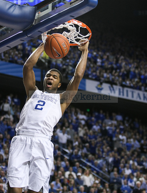Kentucky guard Aaron Harrison makes a breakaway dunk during the second half of the Kentucky vs. Florida game at Rupp Arena in Lexington, Ky.,on Saturday, March 7, 2015. UK defeated Florida 67-50, completing a perfect regular season. Photo by Adam Pennavaria | Staff