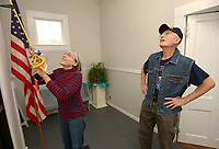 NWA Democrat-Gazette/ANDY SHUPE<br /> Jeffi O'Kane (left), a volunteer with the Friends of the West Fork Library, and Gary Culp, a veteran of the U.S. Air Force from West Fork, speak Thursday, Nov. 8, 2018, while rehearsing for a bell ringing planned for 11 a.m. Sunday to mark the 100th anniversary of the end of World War I at Library Hall in West Fork. Bells across the state will be ringing on the 11th hour of the 11th day of the 11th month to mark the end of the war with West Fork and the Shiloh Museum of Ozark History being the lone official participants in Northwest Arkansas. After the bell is rung, coffee will be served and visitors are encouraged to linger and visit.
