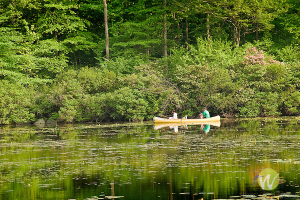 Fishing from canoe on outlet pond, Eagles Mere, PA.