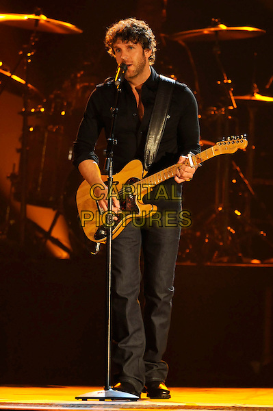 BILLY CURRINGTON .performs during the 43rd Annual CMA Awards, Country Music's Biggest Night, held at the Sommet Center, Nashville, Tennessee, USA, 11th November 2009. live show on stage full length concert gig music guitar microphone  playing black shirt .CAP/ADM/LF.©Laura Farr/AdMedia/Capital Pictures.