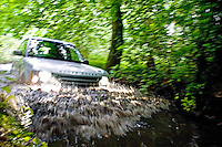 Land Rover Fording a River Deep in the Jungle..©shoutpictures.com..john@shoutpictures.com