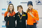 2nd February 2019, Dresden, Saxony, Germany; World Short Track Speed Skating; final, 1500 meters women's event in the EnergieVerbund Arena: Winner Kim Jiyoo (M) from South Korea at the award ceremony next to the runner-up Kim Boutin from Canada (l) and third placed Suzanne Schulting from the Netherlands (r).