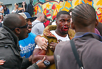 30.08.10 A man at Notting Hill Carnival confronts another man after being hit by a bottle and repeatedly stamped on when he was on the floor.