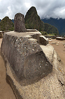 "Intiwatana astronomical observatory. Machu Picchu, the ancient ""lost city of the Incas"", 1400 CA, 2400 meters. Discovered by Hiram Bingham in 1911. One of Peru's top tourist destinations. Huayanapichu (young mountain) in the distance."