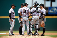 Jupiter Hammerheads manager Kevin Randel (10) talks with the infield, including third baseman Justin Twine (1), shortstop Joe Dunand (3), catcher Roy Morales (14), second baseman Rodrigo Ayarza (hidden), and first baseman John Silviano (22) as he makes a pitching change during the first game of a doubleheader against the Bradenton Marauders on May 27, 2018 at LECOM Park in Bradenton, Florida.  Bradenton defeated Jupiter 13-5.  (Mike Janes/Four Seam Images)