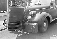Photo from the NIOD's Huizinga collection. A wood gas generator mounted on the front of a passenger car. Gasoline has been scarce since the beginning of the occupation.