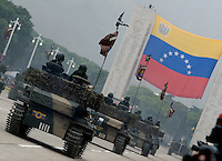 Venezuelan Army armored vehicles with the Venezuelan flag in background, perform a military parade in Caracas, Venezuela, on Wednesday, Jul. 05, 2006. The military parade was to celebrate the 195th anniversary of the Venezuelan Independence from Spain. (ALTERPHOTOS/Alvaro Hernandez)