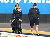 Feb 3, 2016; Chandler, AZ, USA; NHRA top fuel driver Leah Pritchett (left) with team owner Bob Vandergriff during pre season testing at Wild Horse Pass Motorsports Park. Mandatory Credit: Mark J. Rebilas-USA TODAY Sports