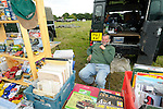 Selling Land Rover models and literature at the autojumble. Dunsfold Collection of Land Rovers Open Day 2011, Dunsfold, Surrey, UK. --- No releases available, but releases may not be necessary for certain uses. Automotive trademarks are the property of the trademark holder, authorization may be needed for some uses.