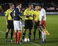 Captains Paul hanlon and Massimo Martino with the match officials in the Scotland v Luxembourg UEFA Under 21 international qualifying match at St Mirren Park, Paisley on 6.9.12.