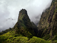 West Maui's historic 'Iao Needle with a backdrop of clouds, 'Iao Valley, West Maui.