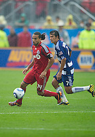 24 July 2010: FC Dallas forward Milton Rodriguez #7 and Toronto FC forward Dwayne De Rosario #14 in action during a game between FC Dallas and Toronto FC at BMO Field in Toronto..The final score was a 1-1 draw...