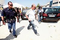 Un familiare di un operaio disperso arriva all'azienda Haemotronic di Medolla, rasa al suolo dalla scossa di terremoto di ieri 29 maggio 2012, per il riconoscimento del corpo recuperato oggi 30 Maggio 2012. ONE SHOT / INSIDEFOTO