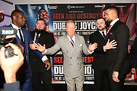 Frank Warren (C) intervenes after Daniel Dubois (L) pushes Joe Joyce during a Press Conference at the BT Tower on 7th February 2020