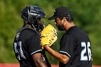 15 July 2011: Starting pitcher Jamel Boutagra of the Senart Templiers talks to Jean Antonio Samer during the 2011 Challenge de France match won 6-5 by the Rouen Huskies over the Senart Templiers at Stade Pierre Rolland, in Rouen, France.
