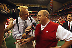 University of Wisconsin head coach Barry Alvarez talks with ESPN's Andrian Karsten after the Alamo Bowl in San Antonio, Texas. The Badgers beat the University of Colorado in overtime 31-28 on 12/28/02. (Photo by David Stluka)