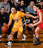 Brittny Membreno #33 of Massapequa, left, dribbles downcourt during the Nassau County varsity girls basketball Class AA semifinals against Syosset at LIU Post on Saturday, Feb. 25, 2017. Massapequa won by a score of 48-44.